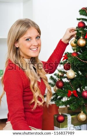 Beautiful young woman with Christmas tree,Decorating Christmas tree