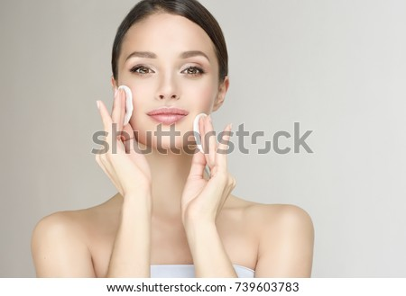 Beautiful Young Woman with Clean Fresh Skin cotton pads . Facial  treatment   . Cosmetology , beauty  and spa .  Skin care . Beauty skin famale  face
