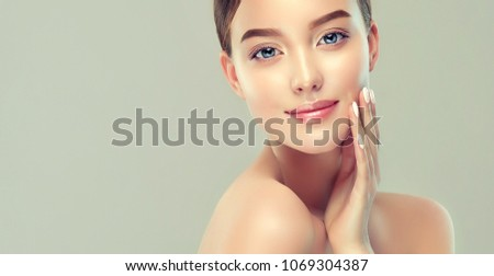 Beautiful Young Woman with Clean Fresh Skin. Face care  . Facial  treatment   . Cosmetology , beauty  and spa .
