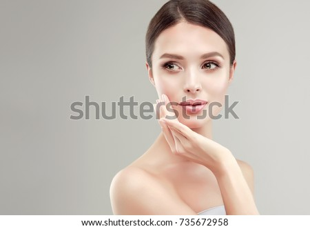 Beautiful Young Woman with Clean Fresh Skin . Facial  treatment   . Cosmetology , beauty  and spa .  Beauty skin famale  face