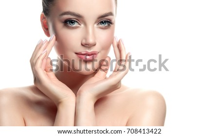 Beautiful Young Woman with Clean Fresh Skin look away  .Girl beauty face care. Facial  treatment   . Cosmetology , beauty  and spa .