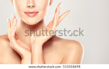 Beautiful Young Woman with Clean Fresh Skin  touch own face . Facial  treatment   . Cosmetology , beauty  and spa . - Shutterstock ID 515018698