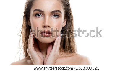 Beautiful young woman with clean perfect skin and wet glossy lips. Portrait of beauty model with natural make up, lifted brows  and long eyelashes.  Spa, skincare and wellness.