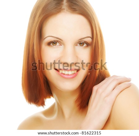 beautiful young woman with clean skin on a white background