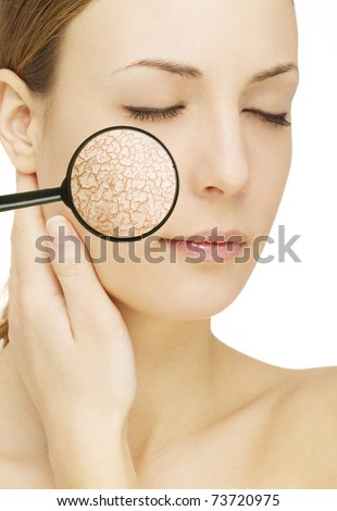 Beautiful young woman with cracked skin
