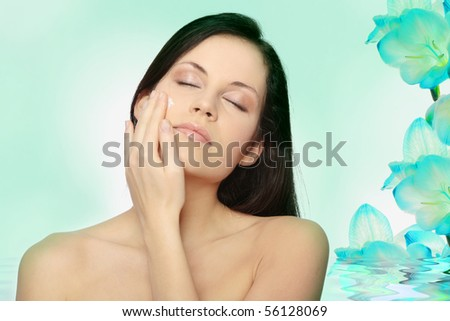 Beautiful young woman with cream.
