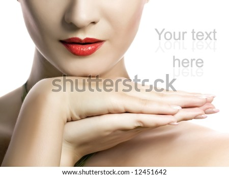 Beautiful young woman with creative make-up on her face - stock photo
