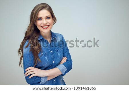 beautiful young woman with crossed arms. isolated portrait. #1391461865