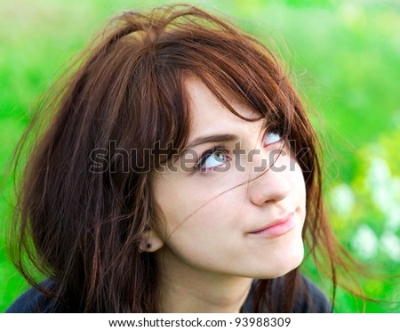 beautiful young woman with cute green eyes - stock photo