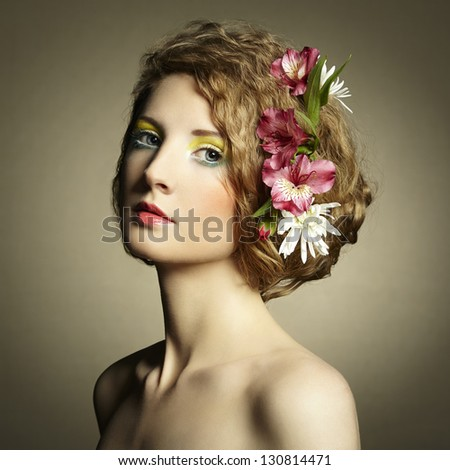 Beautiful young woman with delicate flowers in their hair. Spring photos