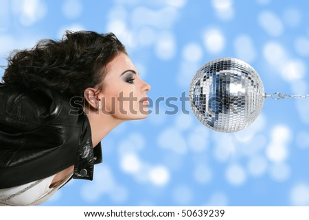 Beautiful young woman with disco ball