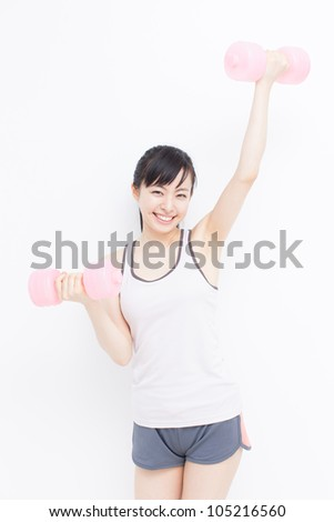 beautiful young woman with dumbbells against white background