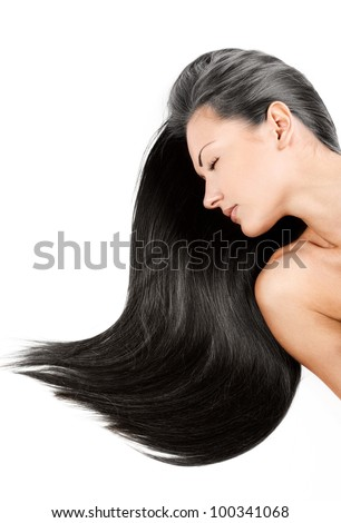 beautiful young woman with elegant long shiny hair , concept hairstyle