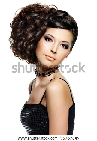 Beautiful young woman with fashion hairstyle and glamour makeup - on white background