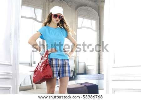 beautiful young woman with fashion sunglasses and handbag