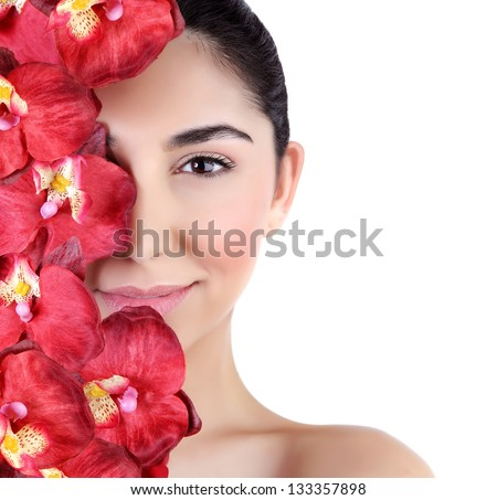 Beautiful young woman with fresh red orchid flowers on half of face isolated on white background, luxury spa salon