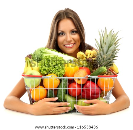 beautiful young woman with fruits and vegetables in shopping basket, isolated on white