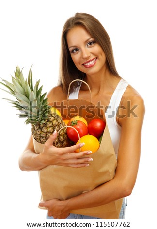 beautiful young woman with fruits in shopping paper bag, isolated on white