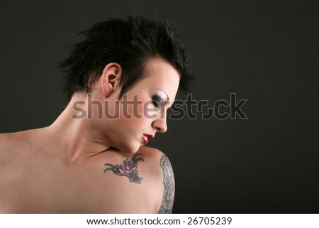 stock photo : Beautiful young woman with gothic hairstyle and makeup