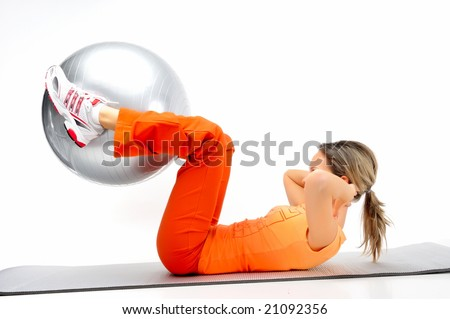 beautiful young woman with gym ball exercising