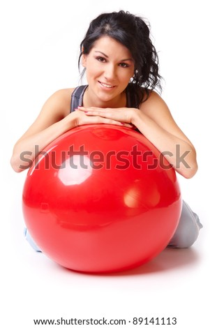 Beautiful young woman with gym ball, isolated on white background
