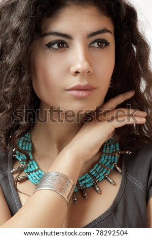 Beautiful young woman with hands on chin retro style fashion portrait