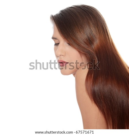 Beautiful young woman with healthy long hair