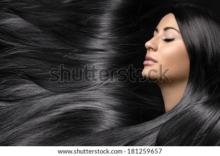 beautiful young woman with healthy long shiny hair
