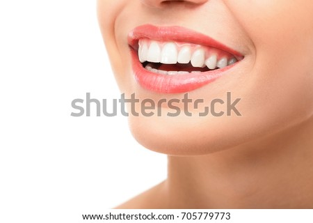 Beautiful young woman with healthy teeth on white background #705779773