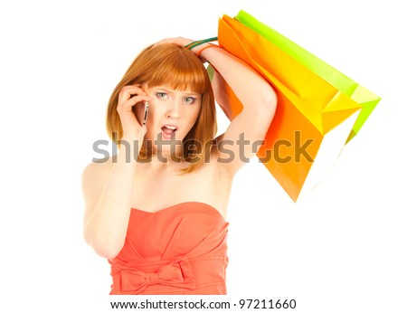 Beautiful young woman with her shopping bags and cellphone