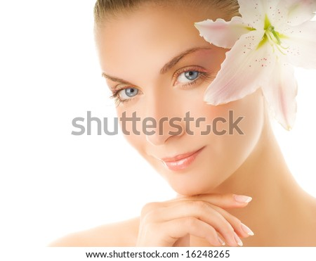 Beautiful young woman with lily flower. Isolated on white background