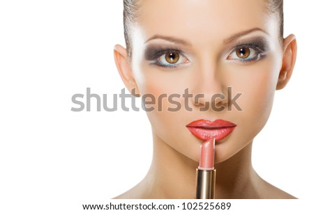 Beautiful young woman with lipstick  isolated on white background