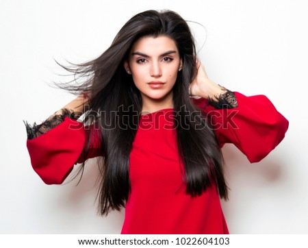 beautiful young woman with long black hair wearing red dress