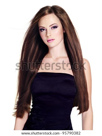Beautiful young woman with  long straight hair, posing on white background