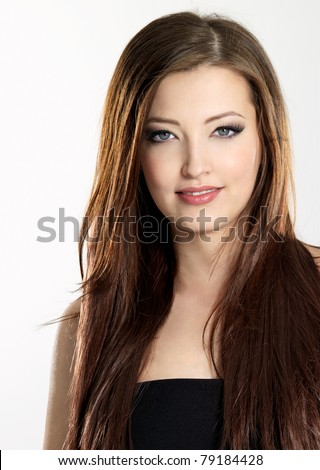 Beautiful young woman with long straight  hair - vertical
