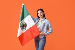 Beautiful young woman with Mexican flag on color background