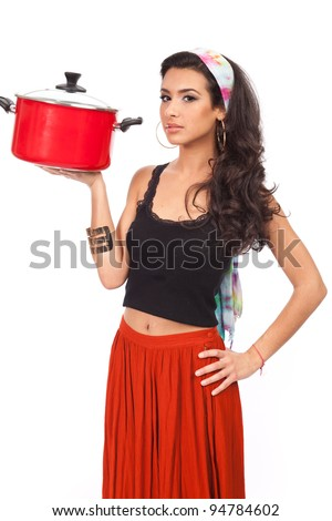 Beautiful young woman with modern Carmen Miranda look with red cooking pot isolated on a white background.