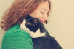 beautiful young woman  with monochrome black and white cat, with retro toning