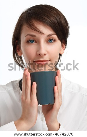beautiful young woman with mug in hands looking straight to viewer, on white background