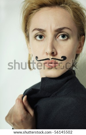 beautiful young woman with  painted mustache wearing jacket