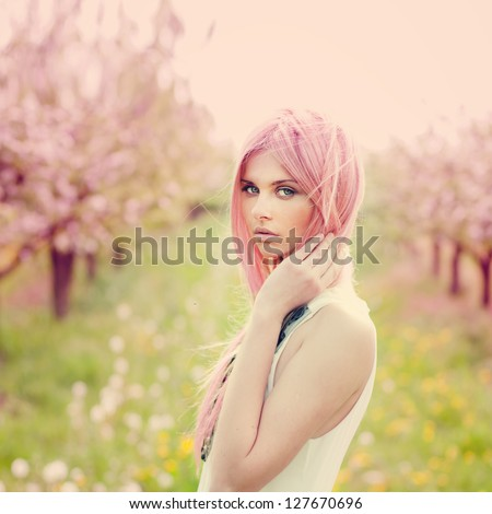beautiful young woman with pink ...