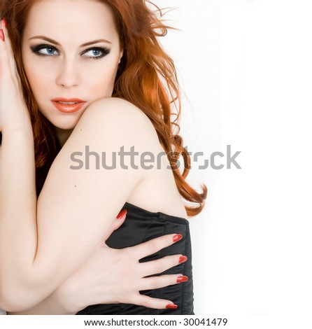 Beautiful young woman with red hair isolated