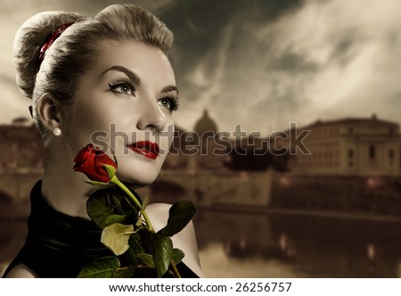 Beautiful young woman with red rose. Retro portrait