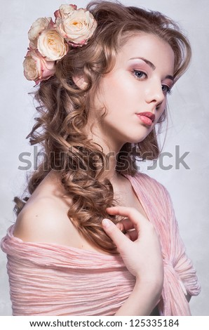 beautiful young woman with roses in the hair