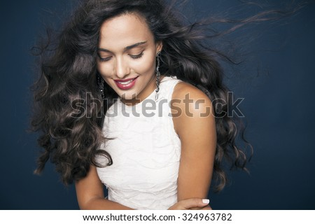 beautiful young woman with shine hair and bright makeup smiling. Make up and cosmetics concept. studio shot, horizontal