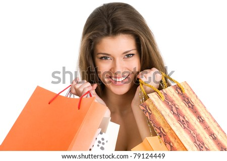 Beautiful young woman with shopping bags over white