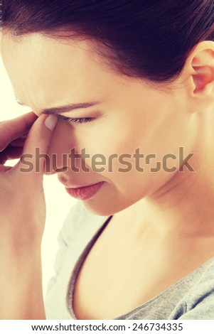 Beautiful young woman with sinus pressure pain.
