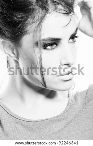 beautiful young woman with strong make up in black and white, small amount of grain added