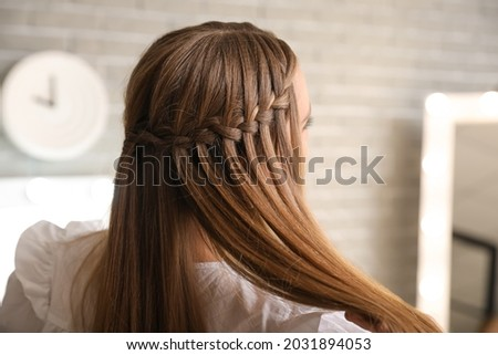 Beautiful young woman with stylish hairdo at home Stock foto ©