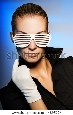 Beautiful young woman with stylish shutter shades sunglasses